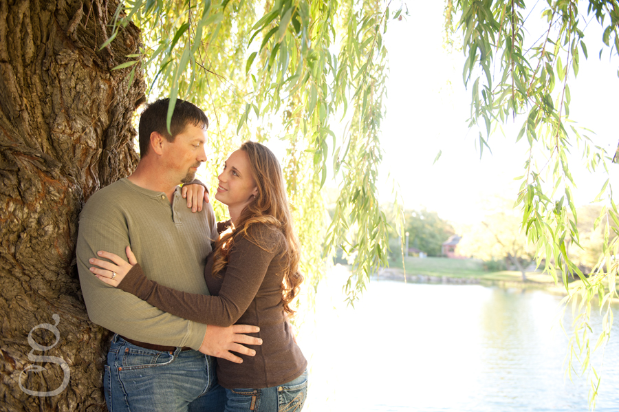 Josh leaning against the willow tree with Jen leaning into him.