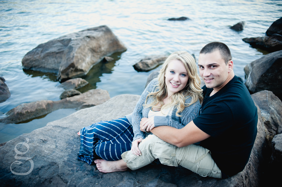 Engaged clients sitting on a large rock out in Devil's Lake, Baraboo.