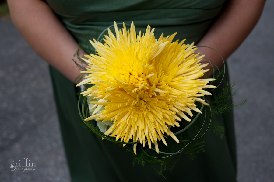 The matron of honor's colorvul yellow bouquet.