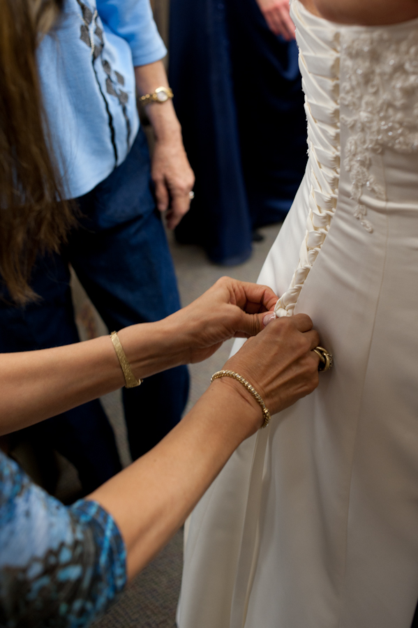 Buttoning up the dress.