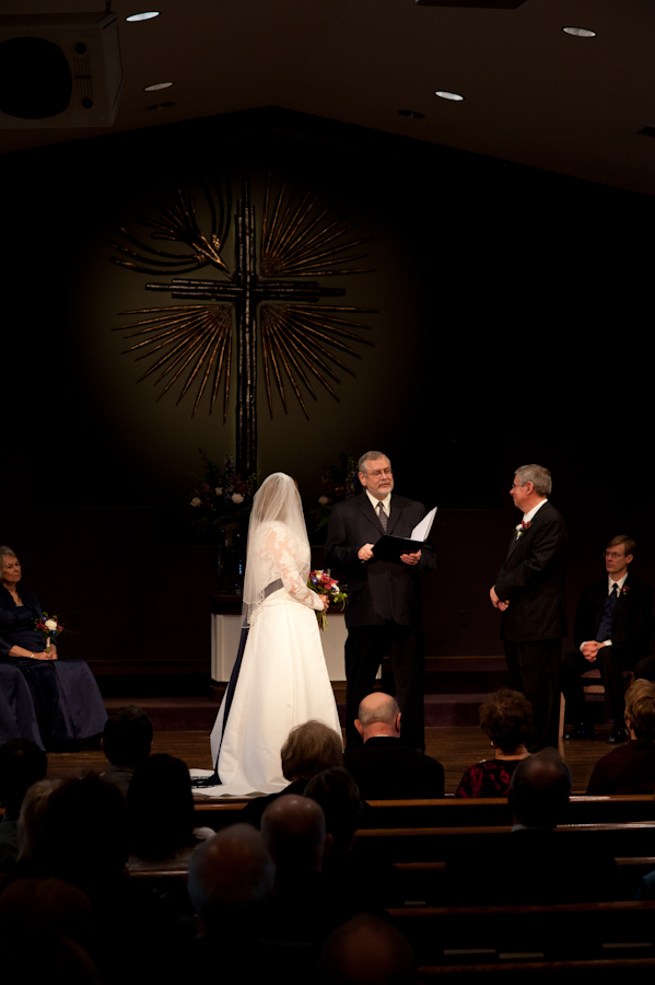 the couple in front of the attending guests at the church.