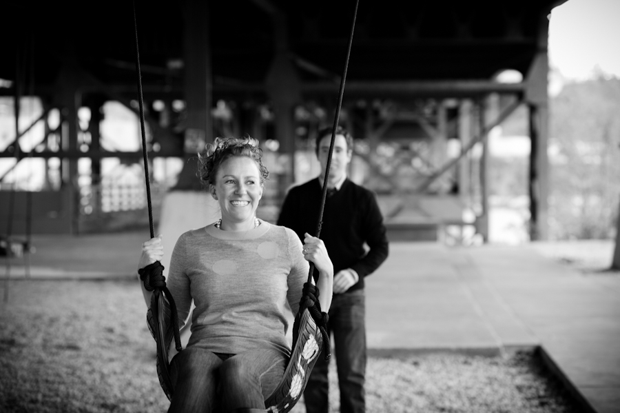 black and white of the couple swinging.