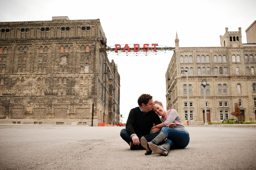 the engaged couple on the road in front of the old Pabst brewery.