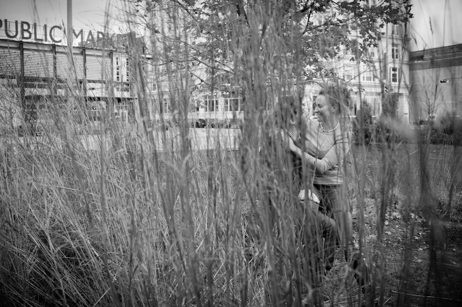Chris and Lianna hiding among the tall grasses in front of the Milwaukee Public Market.