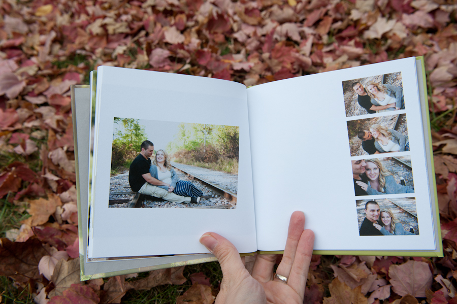 guest book has images of the couple on the railroad tracks.