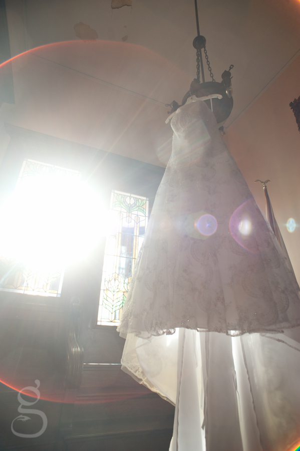 Briana's wedding dress hanging up at the Elk's Club.