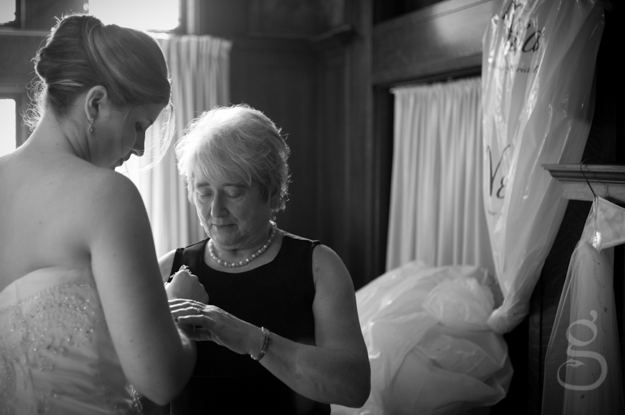 The bride and grandmother putting on finishing touches.