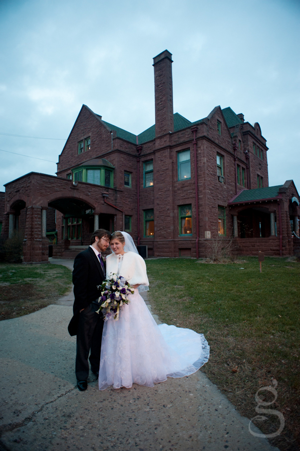 bride and groom in front of the Elk's Club in Baraboo WI.