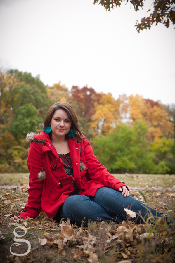 fall leaves and a bright red jacket make this image pop.