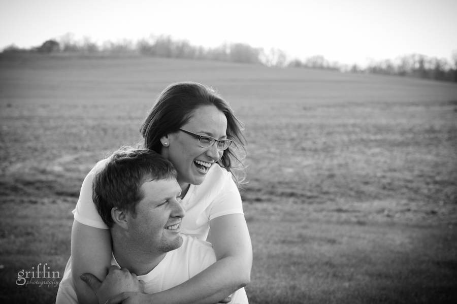 engaged couple laughing at their hilarious photographer.