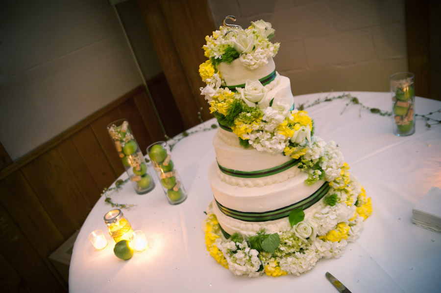 yellow and green with white icing wedding cake