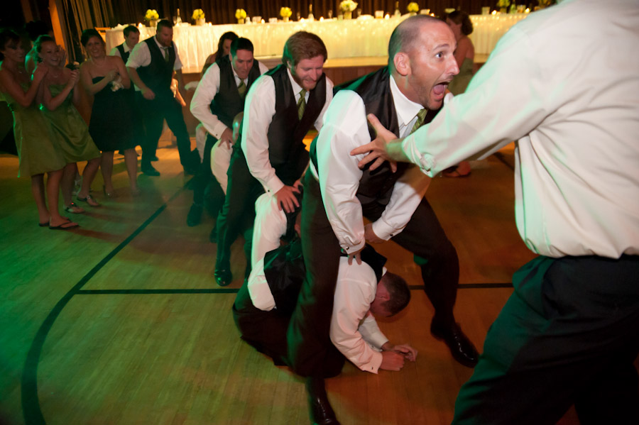 the groomsmen playing leapfrog on the dance floor