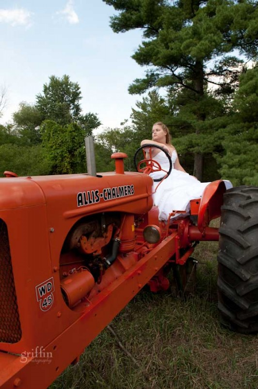 Fearless bride on her Allis Chalmer's pulling tractor.