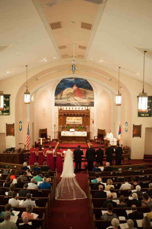 the entire bridal party at the front of the church