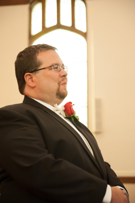 Mike watching his beautiful bride walk down the aisle.