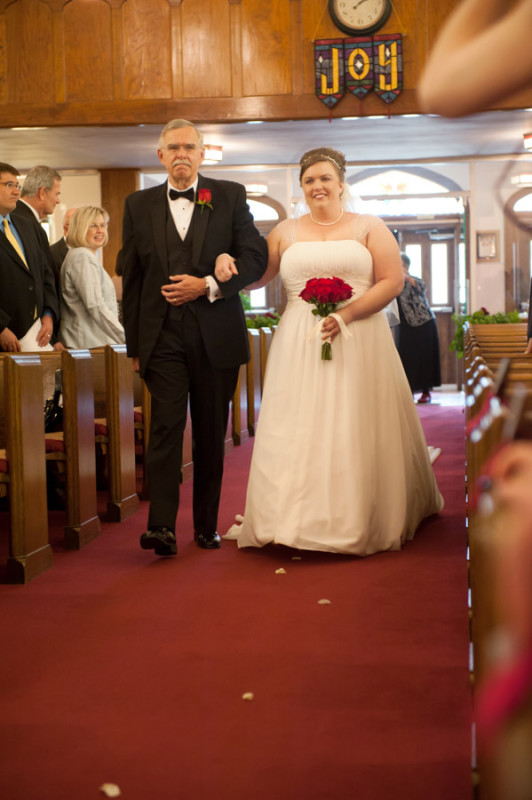 Kasandra and her father walking down the aisle.