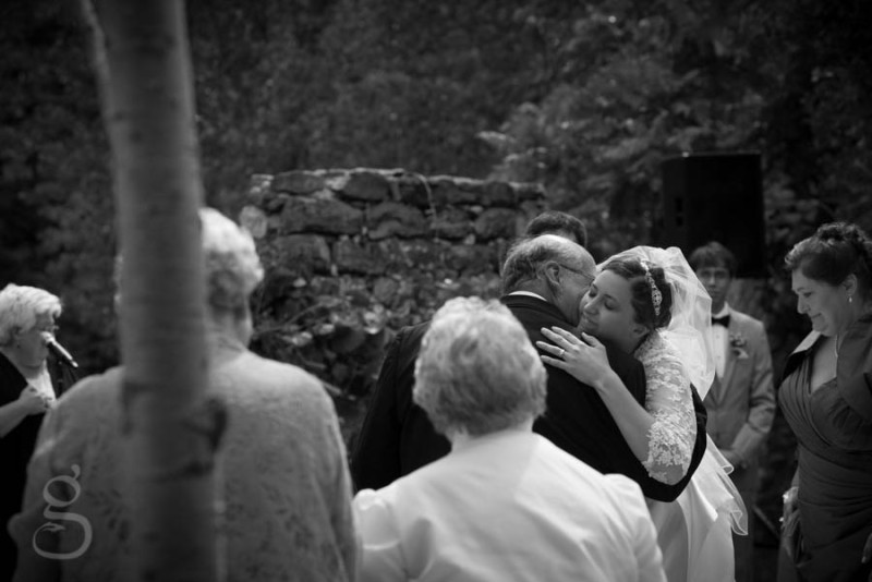 the beautiful bride and her father hugging as he gives her away