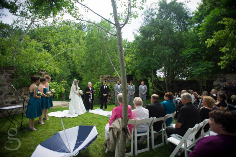 view of the ceremony complete with umbrella in case of rain