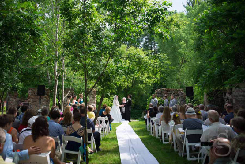 Wedding ceremony inside a fallen down barn