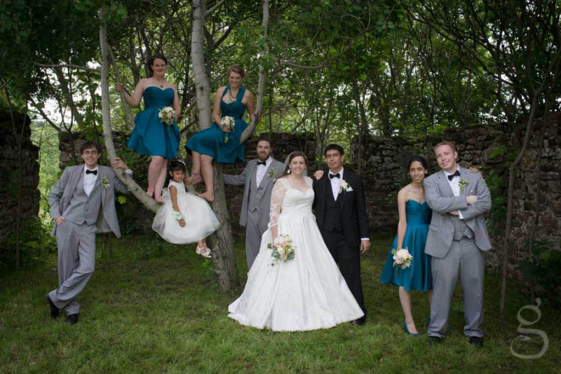 the bridal party climbing in trees