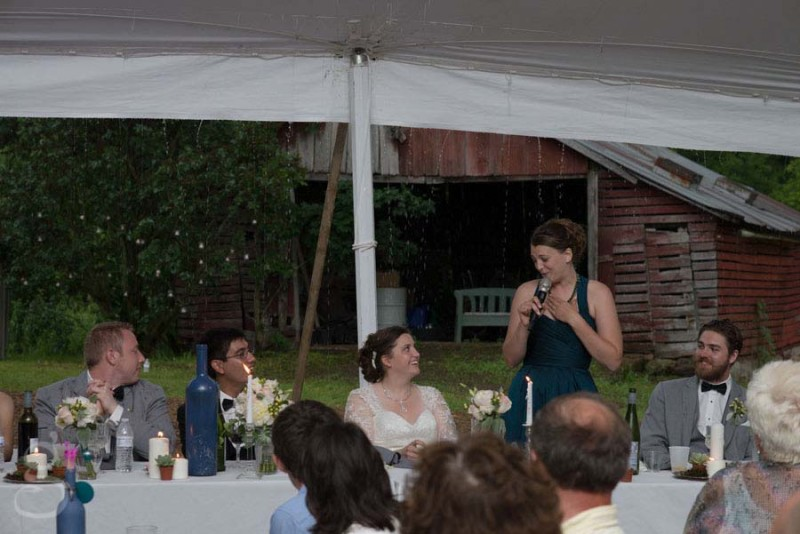 the maid of honor's speech with pouring rain behind her