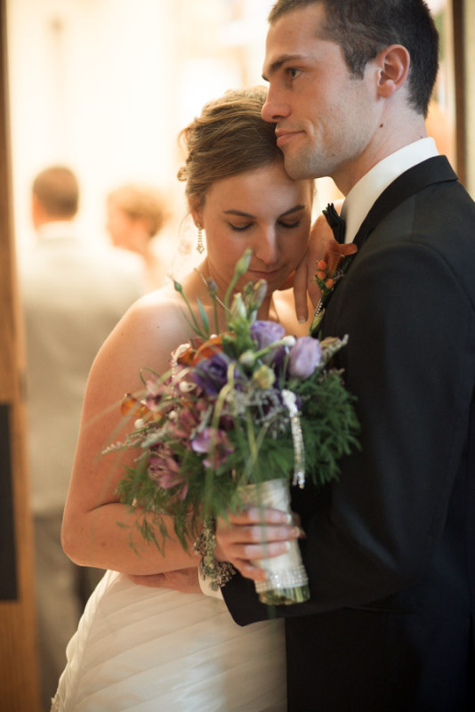 love this bouquet by Amber Moon as the bride leans into the groom.
