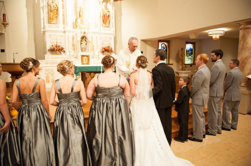 the bridal party in front of the sanctuary at St. Joe's in Baraboo.