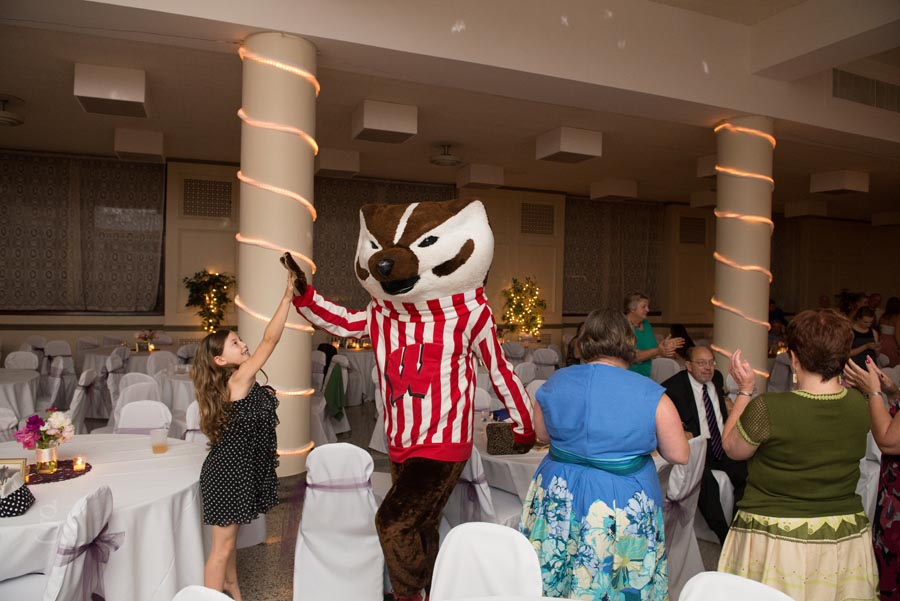 Bucky Badger arrives to crash the wedding reception.
