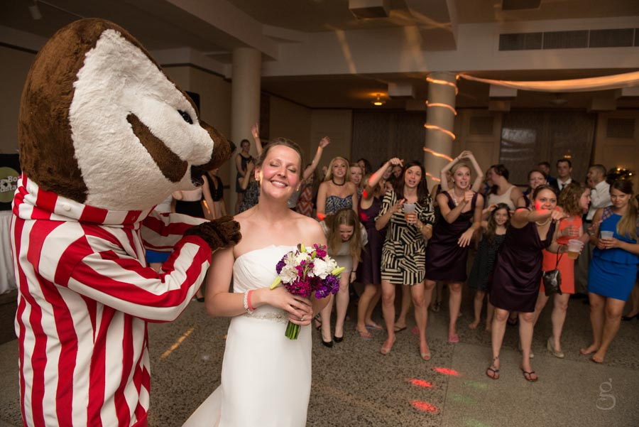 Bucky spinning Emily for the bouquet toss