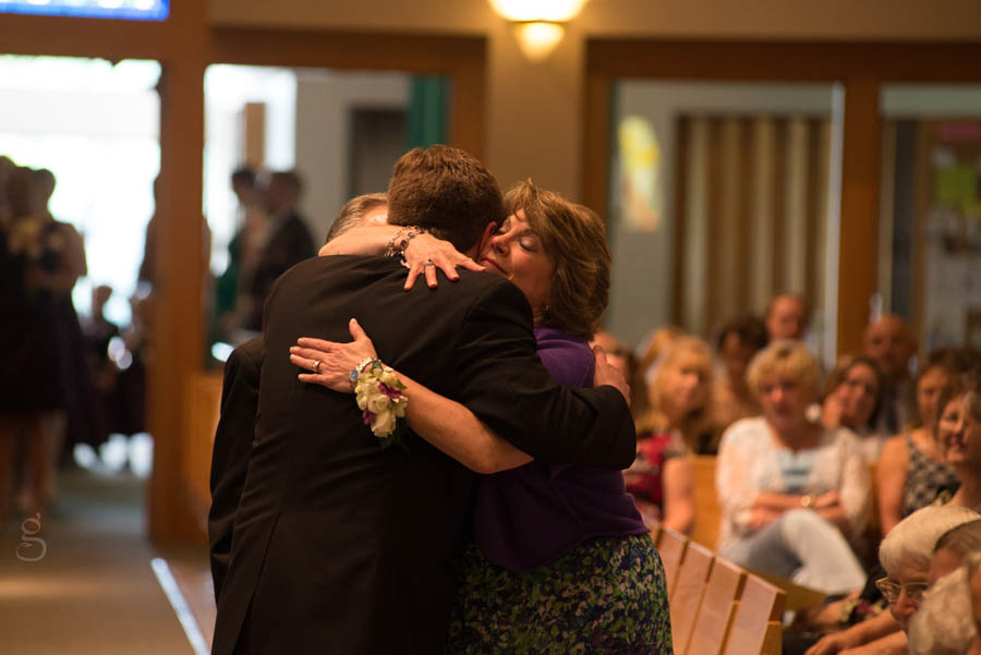 Nick hugging his mom after he walks her down the aisle