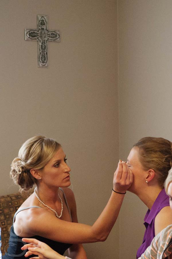 bride getting her makeup done at the church