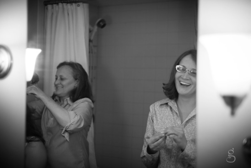 Coty and her mom laughing in the bathroom before they get ready.