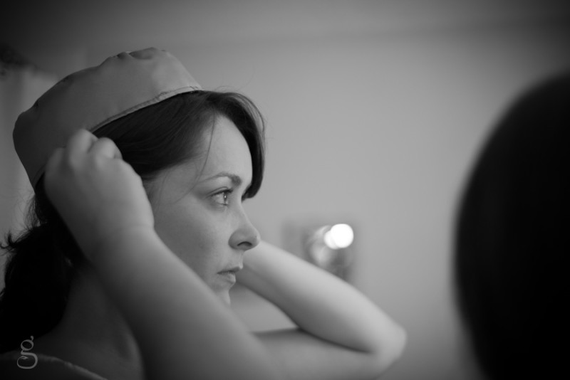 the maid of honor adjusting her oh so cute pill box hat.