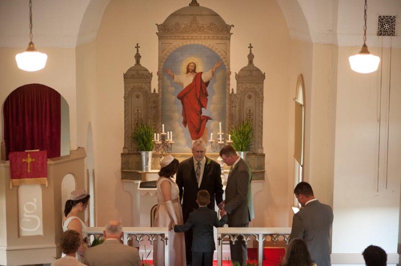 the couple's first prayer as a family at the front of the church