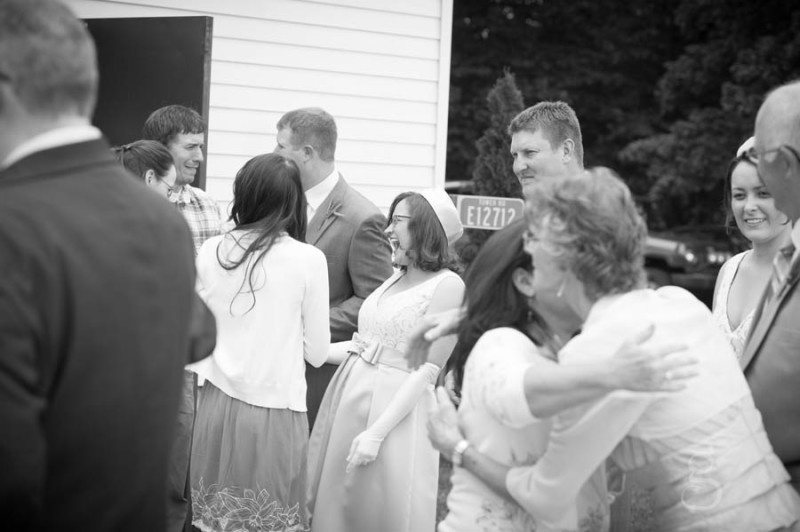laughter and talking in the reception line after the wedding ceremony