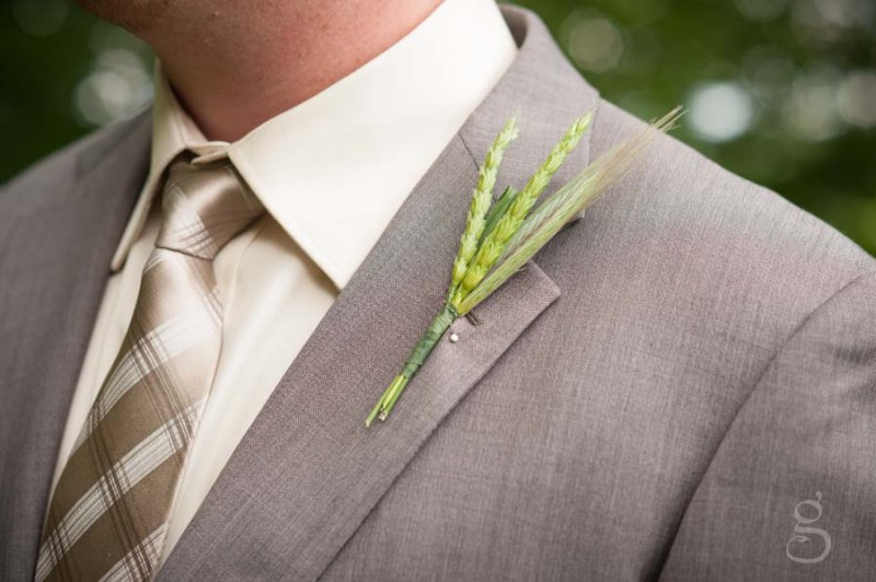 wheat on the groom's lapel.