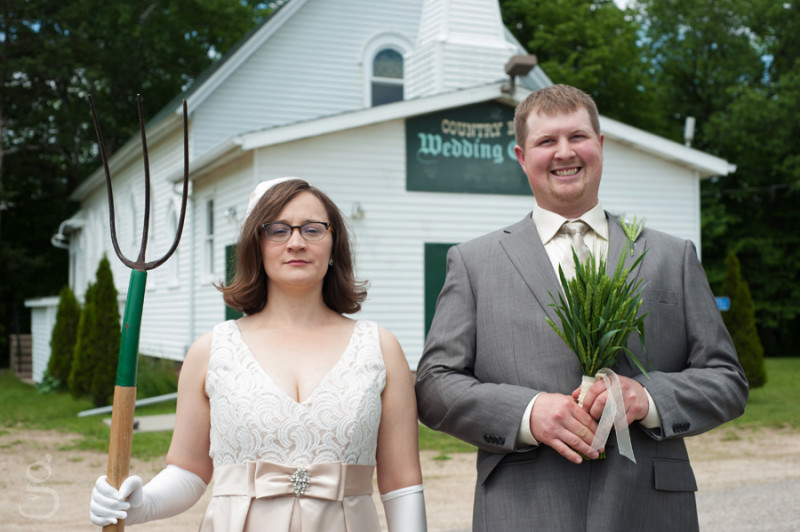 parody of American Gothic for the farming bride and groom