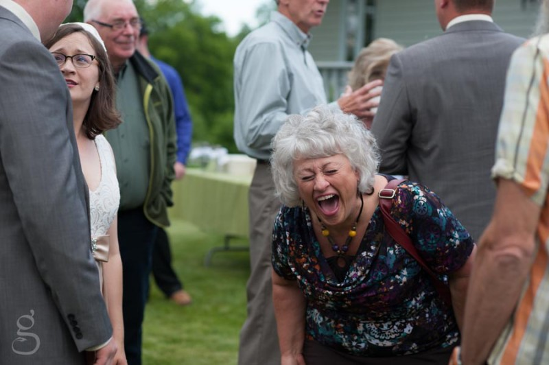 a guest laughing hilariously at the reception.