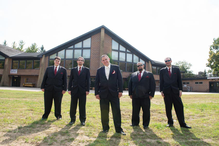 Great groomsmen shot in front of the ski hall.