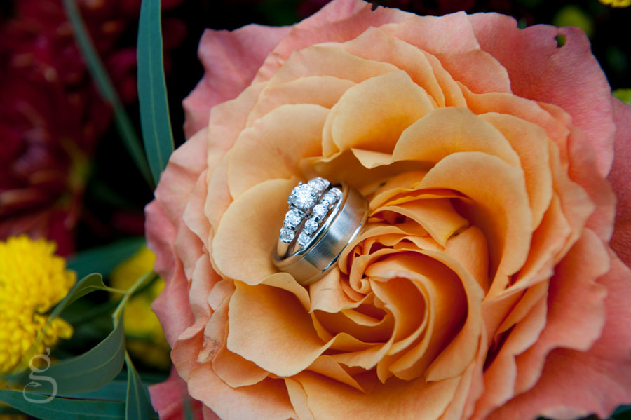 creative wedding ring shot inside a gorgeous peach rose.