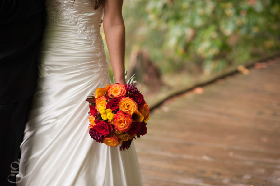 ruched wedding gown and fall colored bridal bouquet.