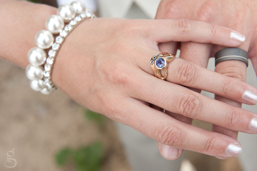 classic wedding bands and hands image.