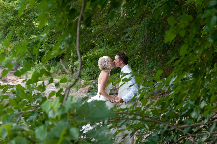 Ninja style wedding photography through the green leaves.