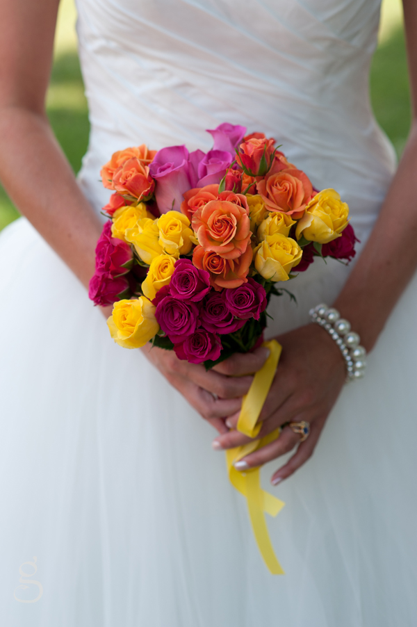 DIY bridal bouquet with uber colorful roses.