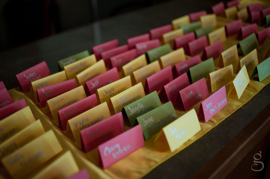 colorful place cards in pink, lime and yellow.