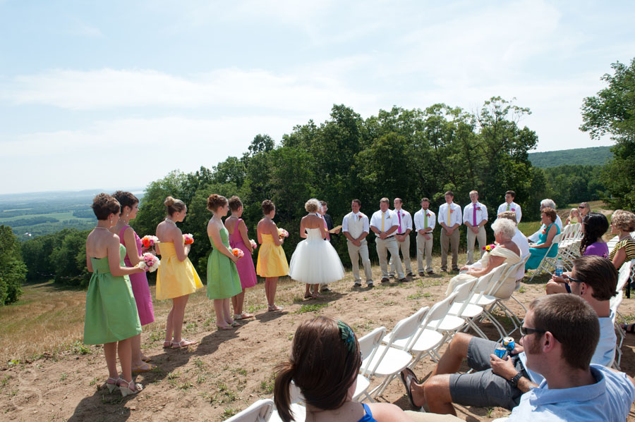 the entire colorful bridal party on top of the ski hill at Devil's Head Resort.