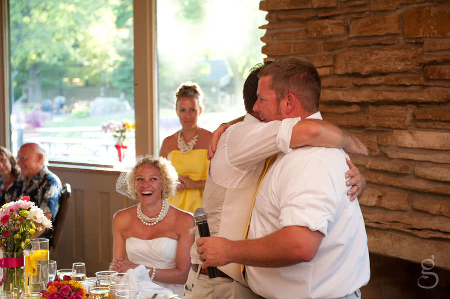 the groom hugging his twin after the speeck.