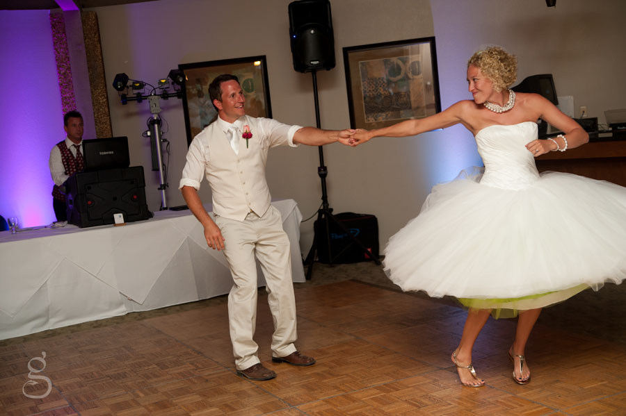 bride and groom twirling on the dance floor.
