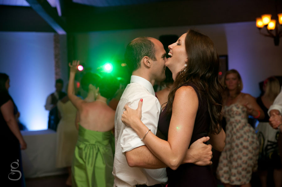 energetic couple on the dance floor amid the green lights.