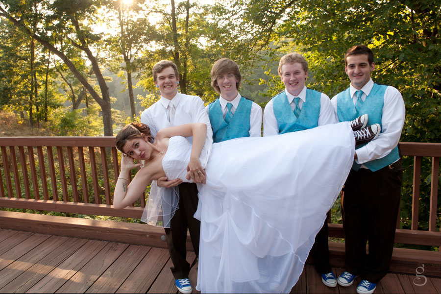 the bride being held up by the groomsmen.